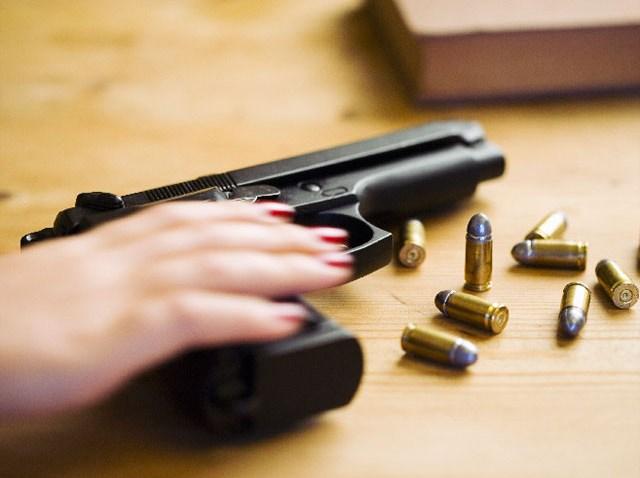 091510 woman gun handgun pistol generic