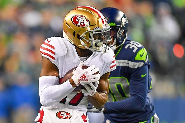49ers receiver Emmanuel Sanders breaks a tackle.