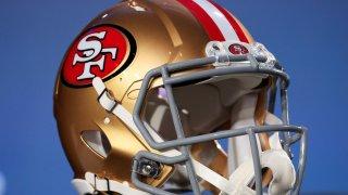 A San Francisco 49ers helmet is displayed.