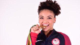 Laurie Hernandez Biting Gold Medal