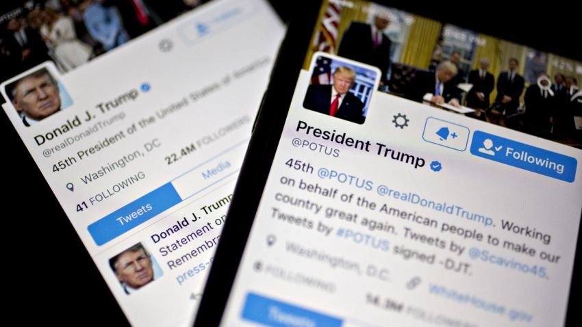 The Twitter Inc. accounts of U.S. President Donald Trump, @POTUS and @realDoanldTrump, are seen on an Apple Inc. iPhone arranged for a photograph in Washington, D.C., U.S., on Friday, Jan. 27, 2017. Mexican President Enrique Pena Nieto canceled a visit to the White House planned for next week after Trump on Thursday reinforced his demand, via Twitter, that Mexico pay for a barrier along the U.S. southern border to stem illegal immigration.
