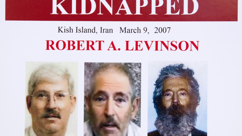 In this March 6, 2012, file photo, an FBI poster showing a composite image of former FBI agent Robert Levinson, right, of how he could look after five years in captivity, and an image, center, taken from the video released by his kidnappers, and a picture before he was kidnapped, left, displayed during a news conference in Washington.