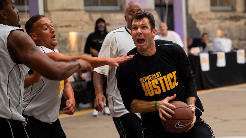 Sacramento Kings coach Luke Walton plays basketball with a team of inmates at Folsom State Prison in Folsom, California, on Dec. 12, 2019.