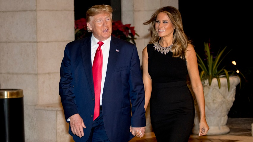 President Donald Trump and first lady Melania Trump arrive for Christmas Eve dinner at Mar-a-lago in Palm Beach, Fla., Tuesday, Dec. 24, 2019.