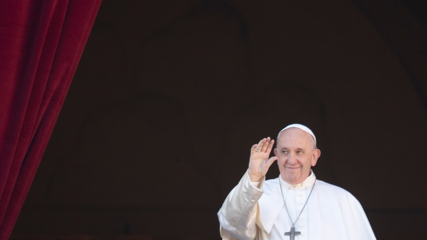 Pope Francis waves to faithful as he arrives to deliver the Urbi et Orbi on Christmas Day, Dec. 25, 2019.