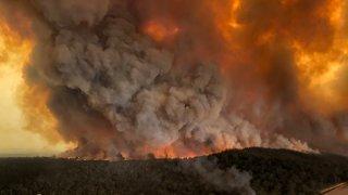 Wildfires rage under plumes of smoke in Bairnsdale, Australia on Dec. 30, 2019.