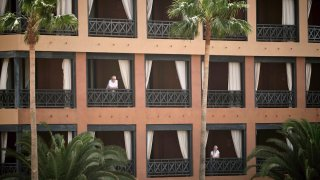 People stand at their balconies at the H10 Costa Adeje Palace hotel in Tenerife, Canary Island, Spain,