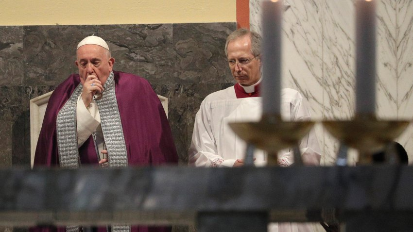 Pope Francis coughs inside the Basilica of Saint Anselmo