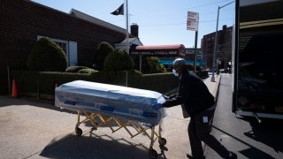 A man delivers caskets to the Gerard Neufeld Funeral Home
