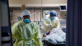 In this April 20, 2020, file photo, a nurse operates a ventilator for a patient with COVID-19 who went into cardiac arrest and was revived by staff at St. Joseph's Hospital in Yonkers, N.Y.