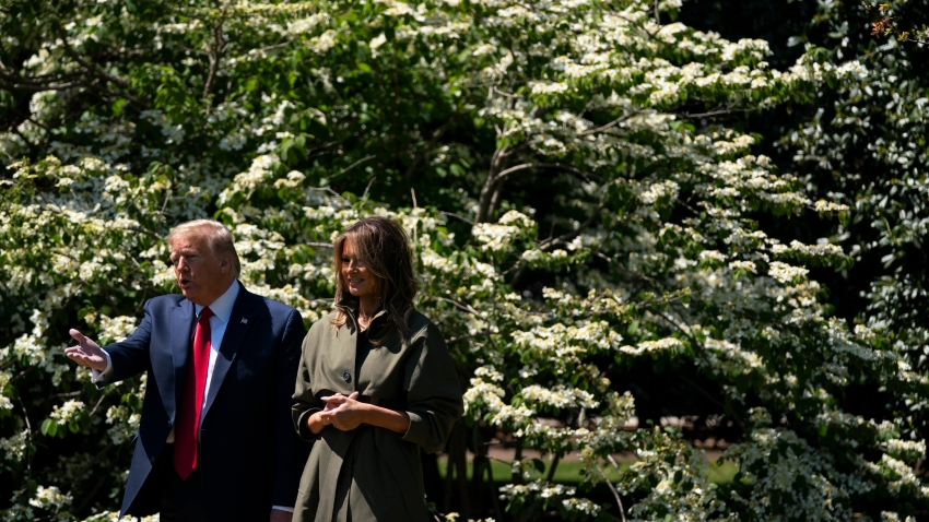 President Donald Trump and first lady Melania Trump participate in a tree planting ceremony to celebrate Earth Day, on the South Lawn of the White House, Wednesday, April 22, 2020, in Washington.