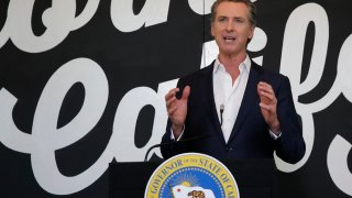Gov. Gavin Newsom discusses his plan for the gradual reopening of California businesses during a news conference at the Display California store in Sacramento, Calif., Tuesday, May 5, 2020.