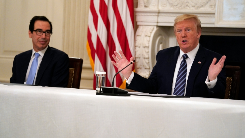 President Donald Trump speaks during a meeting with Republican lawmakers, in the State Dining Room of the White House, Friday, May 8, 2020, in Washington. Treasury Secretary Steven Mnuchinlistens at left.
