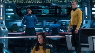 """This image released by CBS All Access shows, from left, Ethan Peck as Spock, Rebecca Romijn as Number One, and Anson Mount as Captain Pike of the the CBS All Access series """"Star Trek: Strange New Worlds."""""""