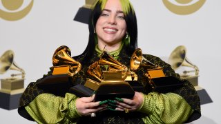"FILE - In this Jan. 26, 2020 file photo, Billie Eilish poses in the press room with the awards for best album and best pop vocal album for ""We All Fall Asleep, Where Do We Go?"", best song and record for ""Bad Guy"" and best new artist at the 62nd annual Grammy Awards in Los Angeles. The Recording Academy is making changes to several Grammy Awards categories, including the often-debated best new artist title, as well as having nomination review committee members sign disclosure forms to prevent conflicts of interest."
