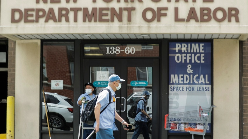 Pedestrians pass an office location for the New York State Department of Labor Thursday, June 11, 2020, in the Queens borough of New York.