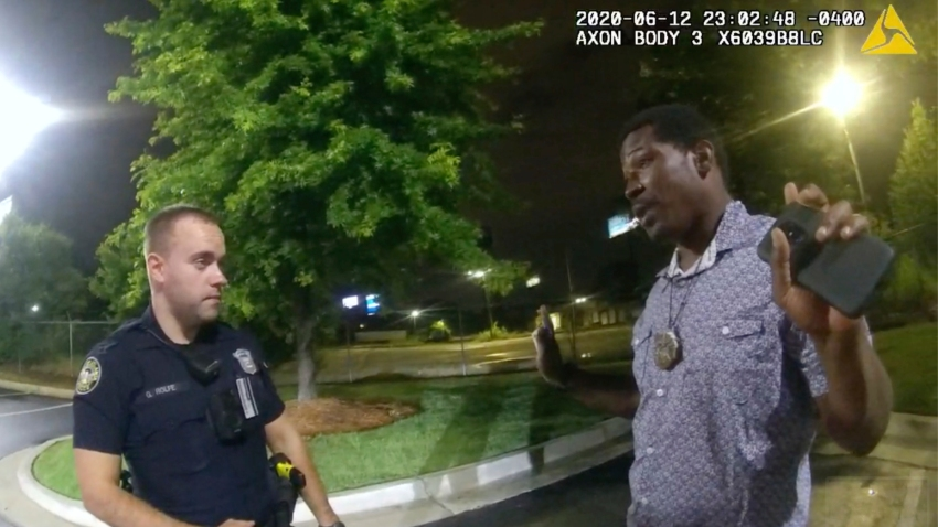 This screen grab taken from body camera video provided by the Atlanta Police Department shows Rayshard Brooks speaking with Officer Garrett Rolfe