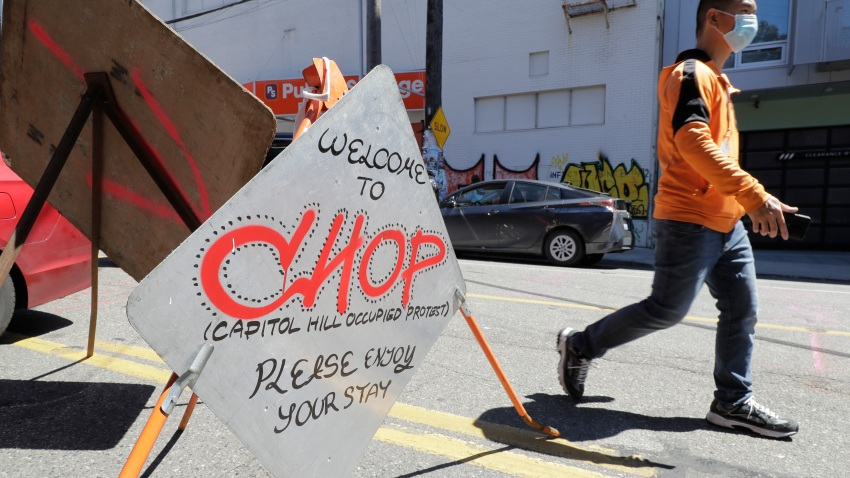A sign welcomes visitors Monday, June 22, 2020, near an entrance to what has been named the Capitol Hill Occupied Protest zone in Seattle.