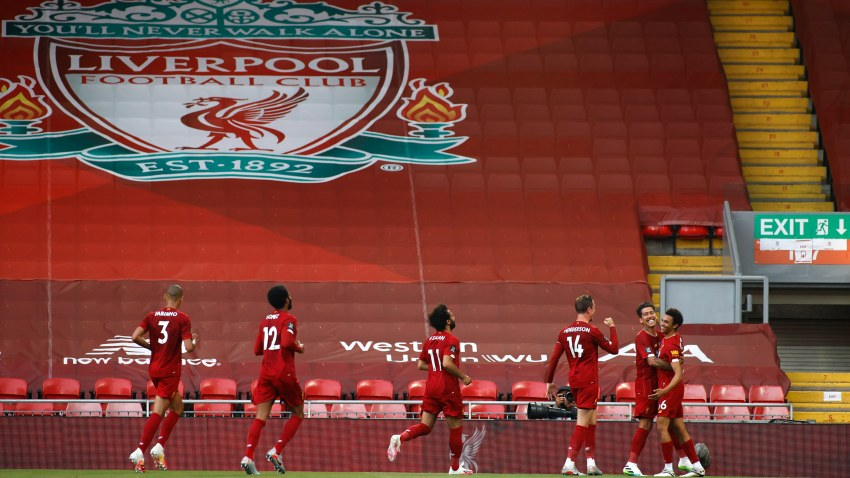 Liverpool's Trent Alexander-Arnold, right, celebrates after scoring the opening goal during the English Premier League soccer match