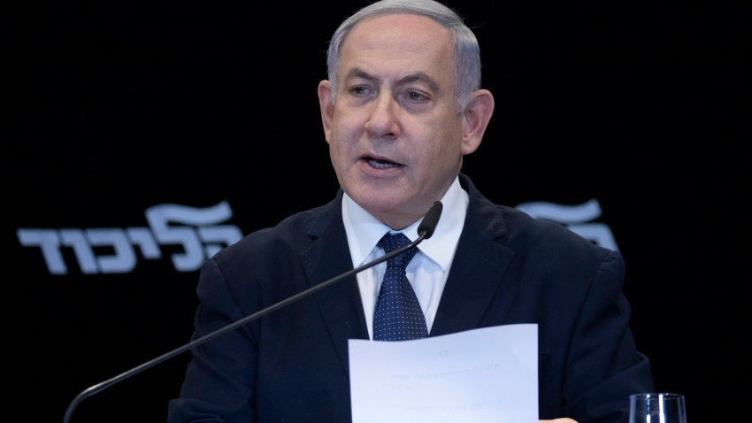 Israeli Prime Minister Benjamin Netanyahu reads a statement in Jerusalem, Wednesday, Jan. 1, 2020.