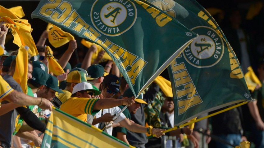 Fans wave flags in the right field bleachers before the start of the Oakland Athletics vs. Detroit Tigers.