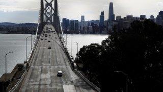 Light traffic crosses the San Francisco – Oakland Bay Bridge.