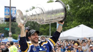 St. Louis Blues defenseman and captain Alex Pietrangelo carries the Stanley Cup during the Blues' NHL hockey Stanley Cup victory celebration in St. Louis on Saturday, June 15, 2019.