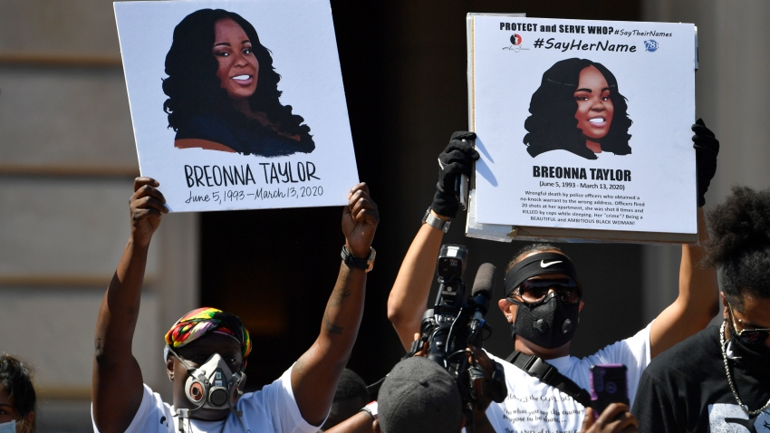 Signs are held up showing Breonna Taylor during a rally in her honor on the steps of the Kentucky State Capitol in Frankfort, Ky., Thursday, June 25, 2020.
