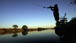 A fisherman casts his line into the Sacramento River.
