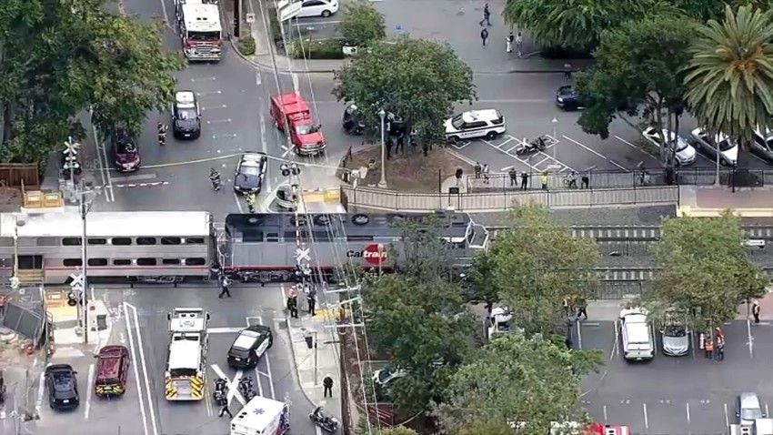 First responders work at the scene of a Caltrain vs. pedestrian collision near the Menlo Park Station.