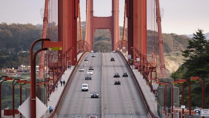 Light traffic moves along the Golden Gate Bridge during rush hour in San Francisco.