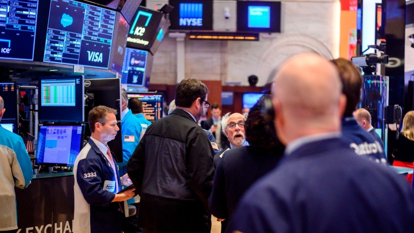 Traders work during the opening bell at the New York Stock Exchange