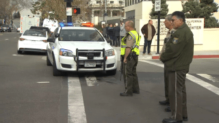 Authorities work outside two evacuated courthouses in San Jose.