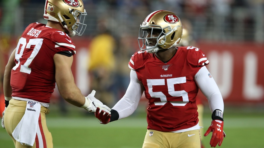 Dee Ford #55 of the San Francisco 49ers congratulates Nick Bosa #97 during the game against the Seattle Seahawks at Levi's Stadium on November 11, 2019 in Santa Clara, California.