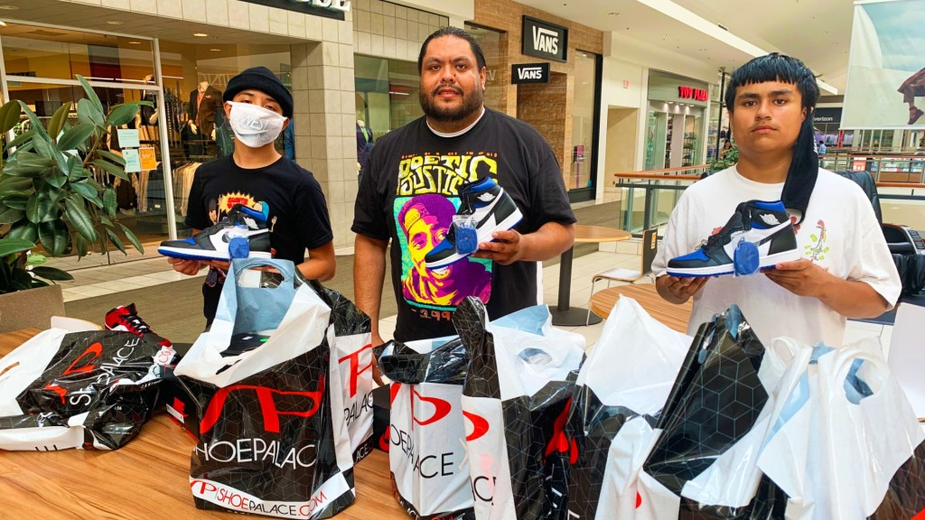 Kevin Zaragoz, Saint Hicks and Toño Bustamante load up on Air Jordans on the reopening day of Solano Town Center mall in Fairfield.