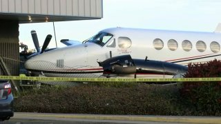 A plane, stolen by a 17-year-old girl, crashes into a building at Fresno Yosemite International Airport on Dec. 18, 2019, in Fresno, California.