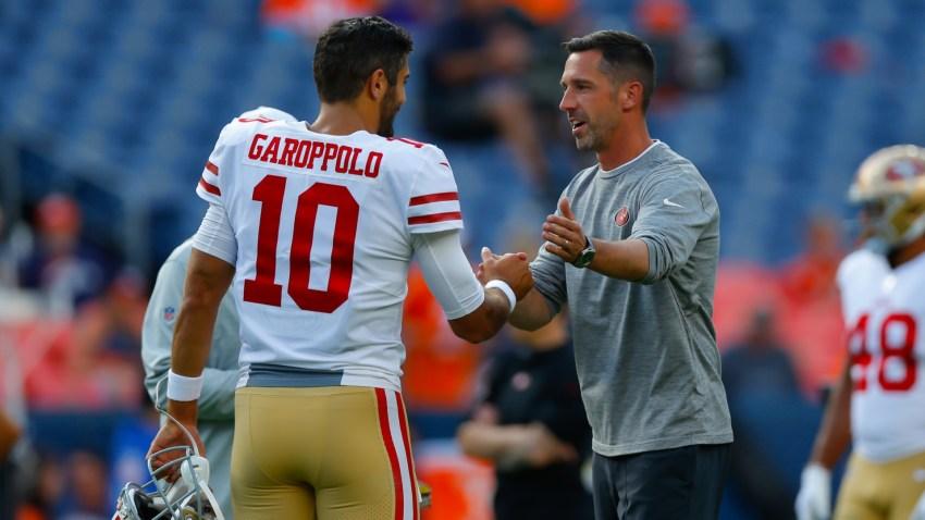 Jimmy Garoppolo and Kyle Shanahan of the San Francisco 49ers shake hands.