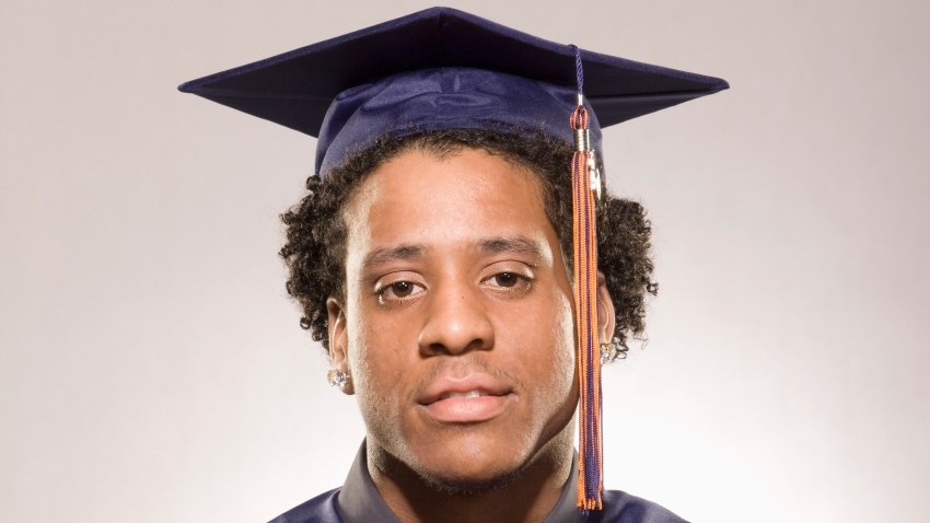 Portrait of a male high school graduate wearing cap and gown