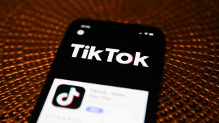 In this Feb. 20, 2020, file photo, the TikTok logo is seen displayed on a phone screen in Poland.
