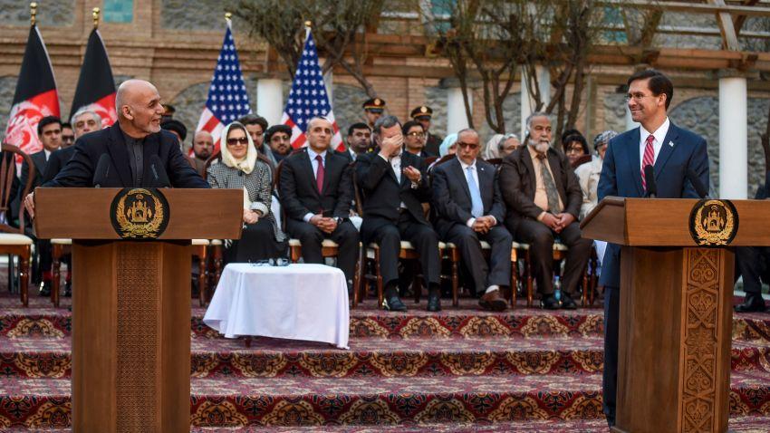 Afghanistan's President Ashraf Ghani, left, speaks as U.S. Secretary of Defense Mark Esper, right, listens