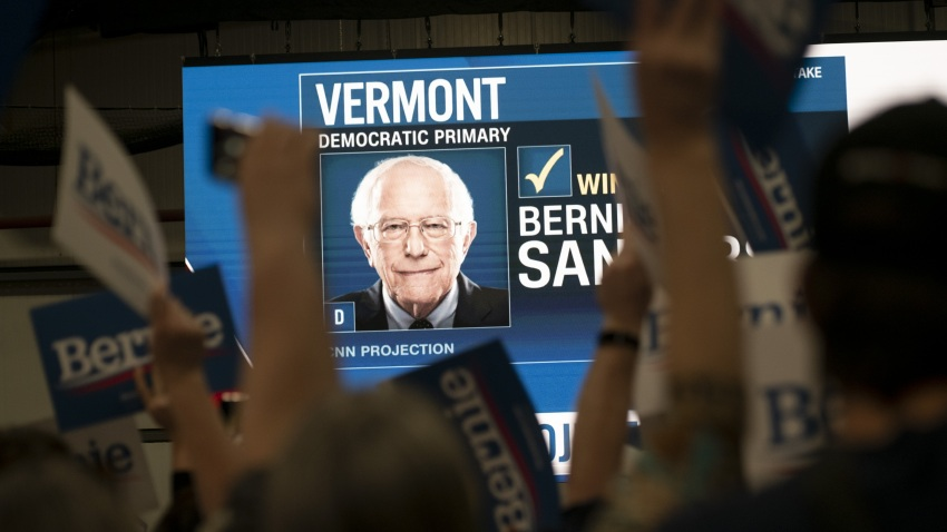 A monitor displays the CNN network calling Senator Bernie Sanders, an Independent from Vermont and 2020 presidential candidate, the projected winner of the state of Vermont during a primary night rally in Essex Junction, Vermont, U.S., on Tuesday, March 3, 2020.