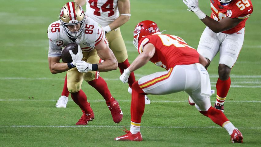 49ers' George Kittle is tacked by Kansas City Chief's Daniel Sorensen.