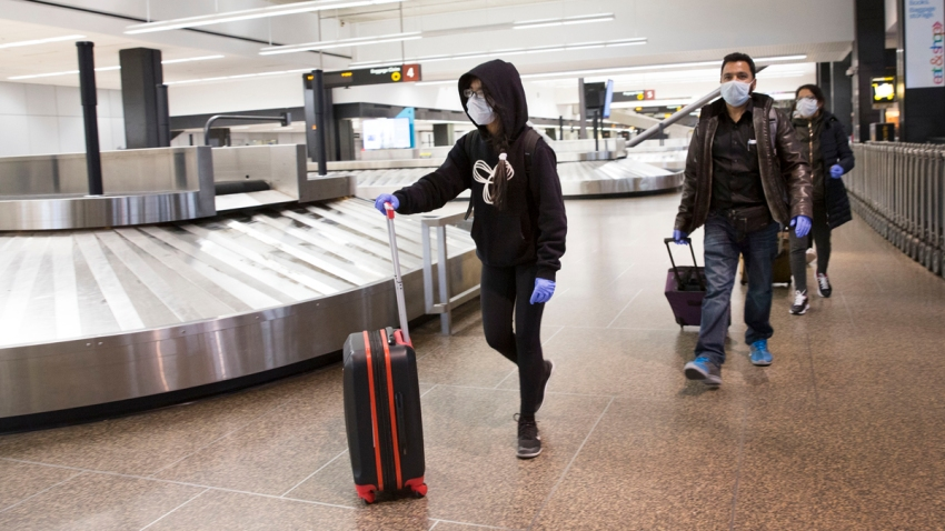 Sukhneet Dhillon (L), age 11, and her family arrives on a flight from India that went through Tokyo at the SeattleTacoma International Airport (also known as Sea-Tac Airport) on March 8, 2020 in Seattle, Washington.