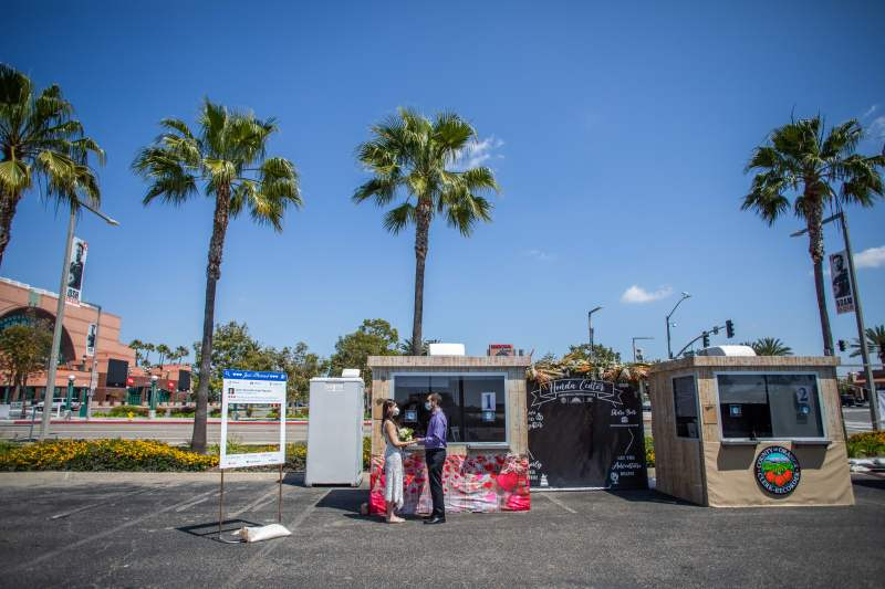Photos: Love Conquers All in This Anaheim Parking Lot, Where Couples Are Saying 'I Do'
