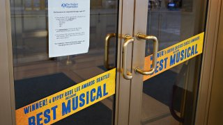 A show suspension sign in the window of Broadway's 'Come From Away'