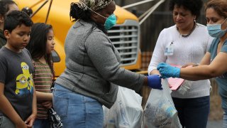 Dozens of families receive food distributed