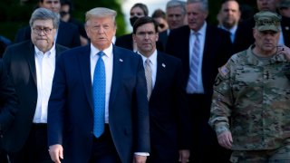 U.S. President Donald Trump walks with US Attorney General William Barr (L), US Secretary of Defense Mark T. Esper (C), Chairman of the Joint Chiefs of Staff Mark A. Milley (R), and others from the White House to visit St. John's Church after the area was cleared of people protesting the death of George Floyd June 1, 2020, in Washington, D.C.