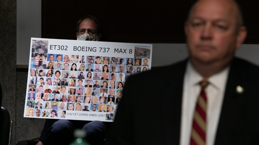 Michael Stumo holds a sign displaying photographs of the those killed in the March 10, 2019, crash of Ethiopian Airlines Flight 302 as Federal Aviation Administration (FAA) chief Steve Dickson testifies before a Senate panel examining the safety certification of jetliners on June 17, 2020 in Washington, DC.