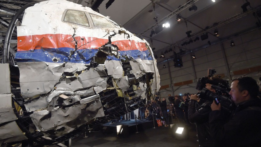 In this file photo, the wrecked cockpit of the Malaysia Airlines flight MH17 is presented to the press during a presentation of the final report on the cause of the its crash at the Gilze Rijen airbase October 13, 2015.