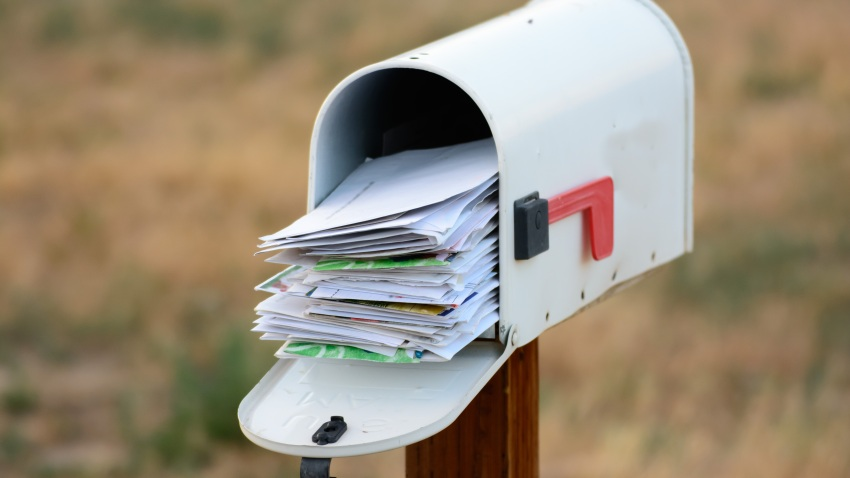 A mailbox overflows with mail in this file photo.